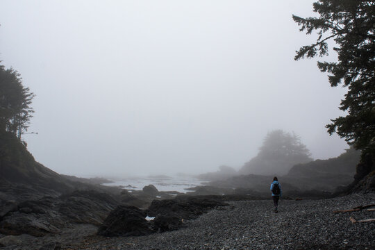 Stock Photo of a Young Woman Hiking in the Fog at Botanical Beach, Vancouver Island, BC.