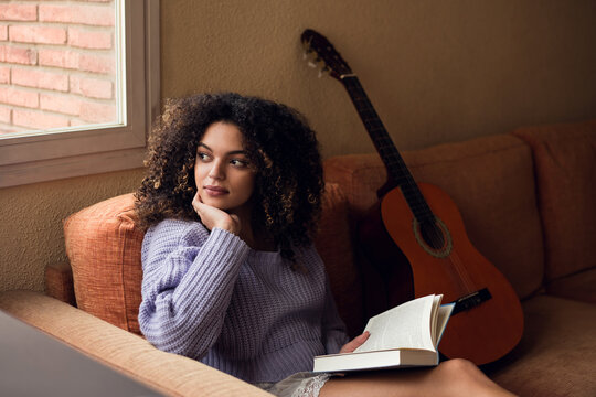 Female student reading at home