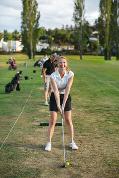 Middle age woman portrait at golf driving range