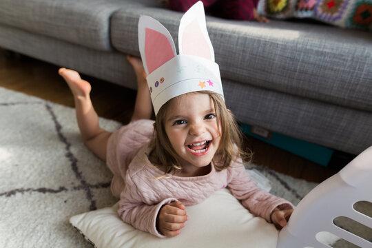 little girl with homemade bunny ears