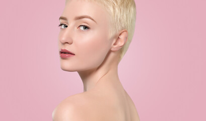 Portrait of a beautiful woman with short blonde hair, beautiful fresh make-up and with healthy clean skin on a pink background. Make-up and cosmetology concept.