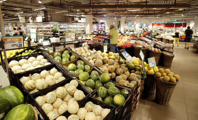 Fruits and vegetables are displayed at the fresh market department at a supermarket of Swiss retail group Migros in Zurich