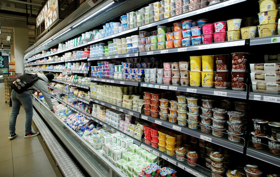 Various products are displayed on a refrigerated shelf at a supermarket of Swiss retail group Migros in Zurich