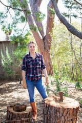Woman chopping wood outdoors