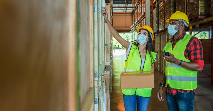 factory workers work with face mask to protect coronavirus covid-19