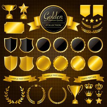 金色のメダル、バッジ、リボン、王冠、トロフィーのセット
