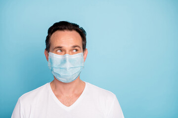 Close-up portrait of his he nice pensive guy wearing safety gauze mask stop pathogen mers cov...