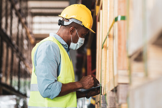 African worker wear protective face mask in warehouse