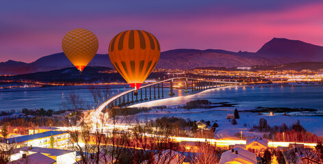 Hot air balloon flying over arctic city of Tromso in Northern Norway - Tromso, Norway