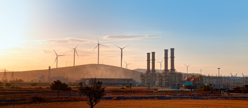 Industrial concept - Silhouette of Natural gas processing plant with Renewable energy wind turbines generating electricity