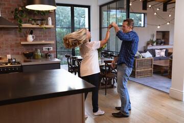 Senior Caucasian couple Dancing at home