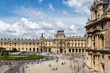 PARIS, FRANCE- JULY 29: The main building of the Louvre Museum on July 29, 2014. The Louvre Museum is one of the largest museums of the world