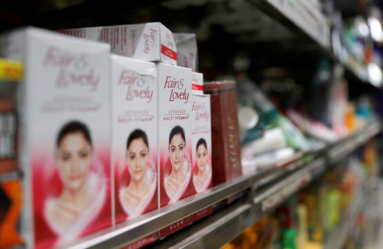 """""""Fair & Lovely"""" brand of skin lightening products are seen on the shelf of a consumer store in New Delhi"""