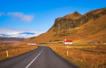 Iceland landscape, road and church with red roof mountain panorama beautiful islandic nature outdoor