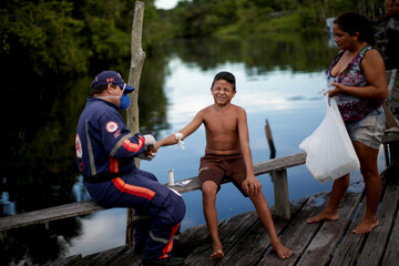 "The Wider Image: ""How many people are going to die?"" - COVID-19 races up the Amazon"