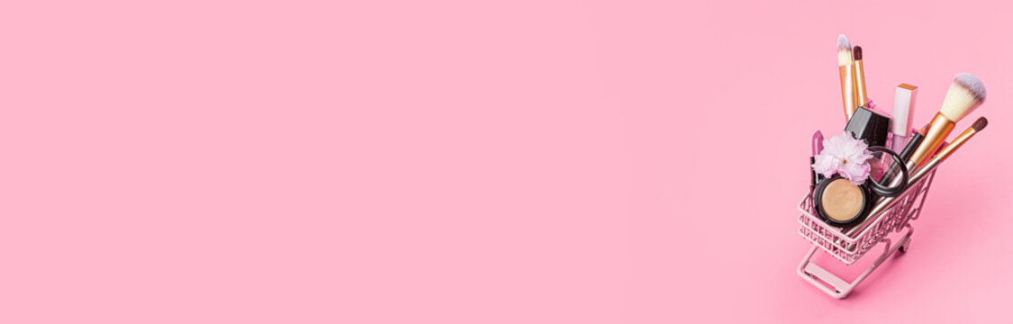Cosmetic products on pink background. Horizontal web banner with copy space, mockup, template.