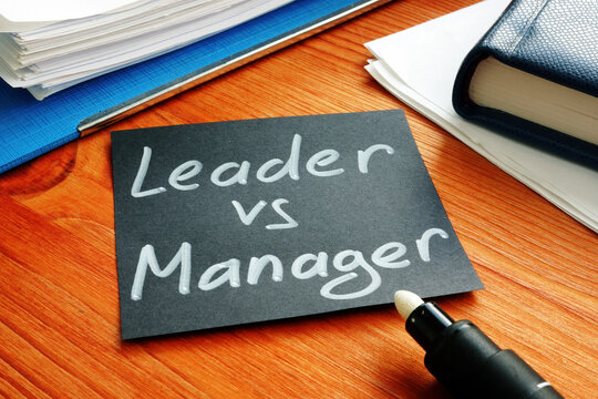 Leader vs manager is shown on the conceptual business photo