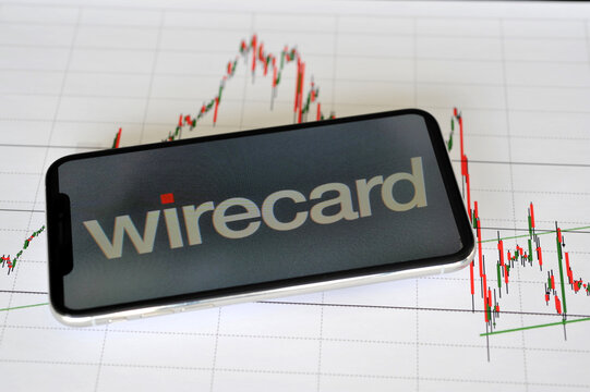 Hamburg / Germany - October 27, 2019: Close-up of a smartphone wih the logo of wirecard AG on a candlestick-chart - Wirecard is a financial services provider headquartered in Aschheim, Germany