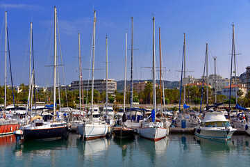 Harbor of Cannes in France with sailboat and speedboats, a city located on the French Riviera in the Alpes-Maritimes department