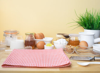 Selective focus.Cooking breakfast food or bakery with ingredient and copy space of tablecloth