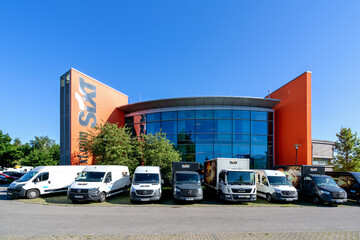 ROSTOCK, GERMANY - JUNE 14, 2020: Sixt rental office. Sixt SE is a European multinational car rental company with about 4,000 locations in over 100 countries.