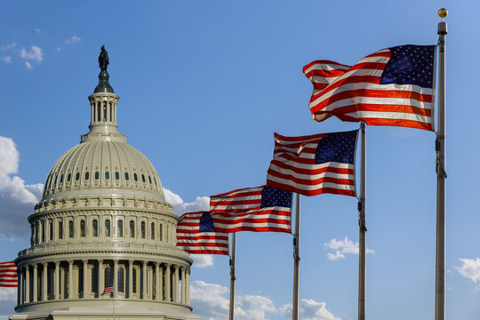 Capitol building in Washington, DC with United States flags
