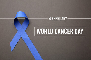 Blue ribbon on grey background, top view. World Cancer Day