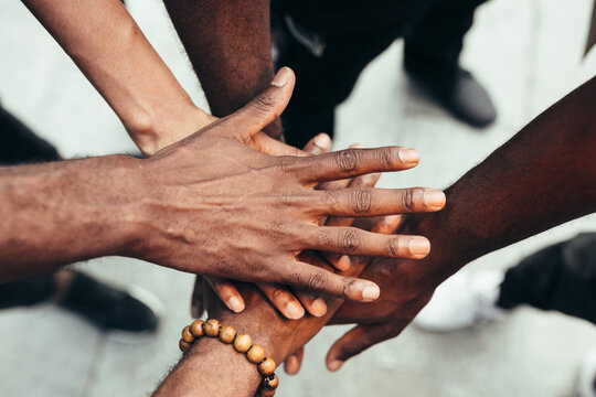 Group of friends stacking hands against racism. Black Lives Matters concept.