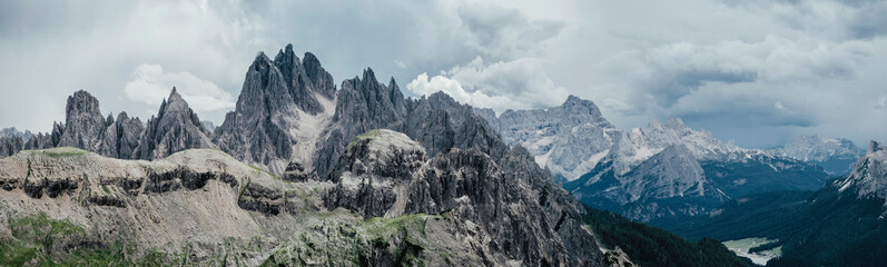 Panoramic view of rocky mountains against cloudy sky, South Tyrol, Italy