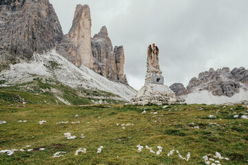 Poster Historisch geb. Weathered statue by stack rocks against sky, South Tyrol, Italy