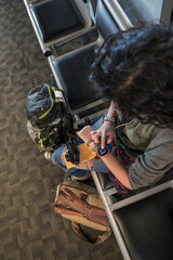 Woman with smart watch waiting in airport departure area