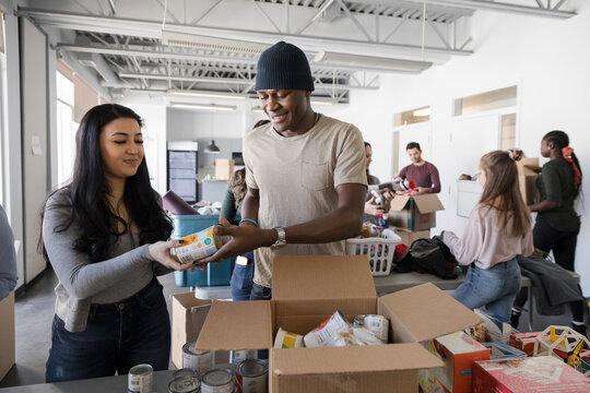 Volunteers sorting food donations in community center
