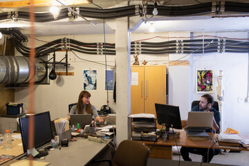 Business people working in basement office
