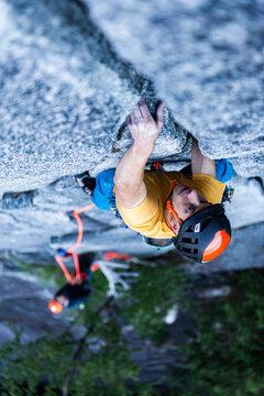 Man lead rock climbing trad on granite Squamish Stawamus Chief