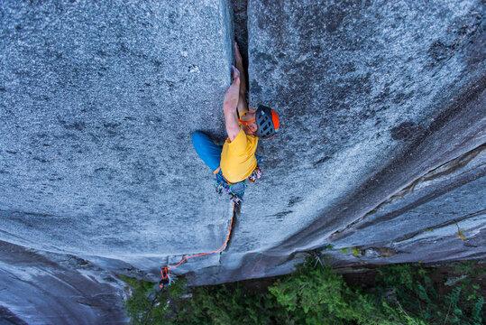 man lead climbing off width granite climb in Squamish Canada BC
