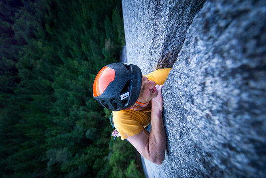 Man struggling lead climbing in off-width climb on granite Squamish