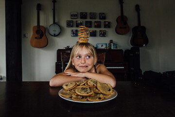 Young girl balancing cookies on her head