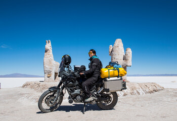 Poster Historisch geb. woman sitting on her adventure touring bike at Salinas Grandes / Jujuy
