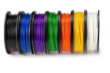 Obraz Black, red, blue, green, violet, orange, yellow, white filament 3d printer isolated on white background - fototapety do salonu