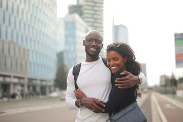 portrait of young couple embraced on the street