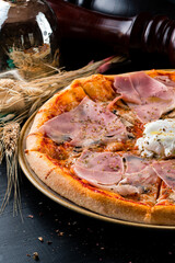italian pizza with ham and poached egg