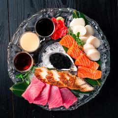 japanese foods sashimi. Mixed sliced fish sashimi in dark background top view, flat lay