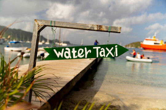 Handmade sign for water taxi on island of Bequia in the Caribbean