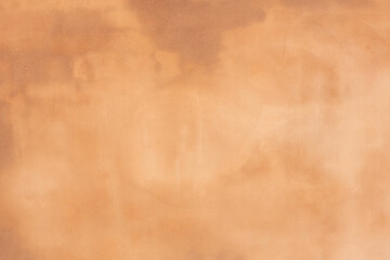 rusty brown orange textured outdoor wall with stains and a rough exterior wall