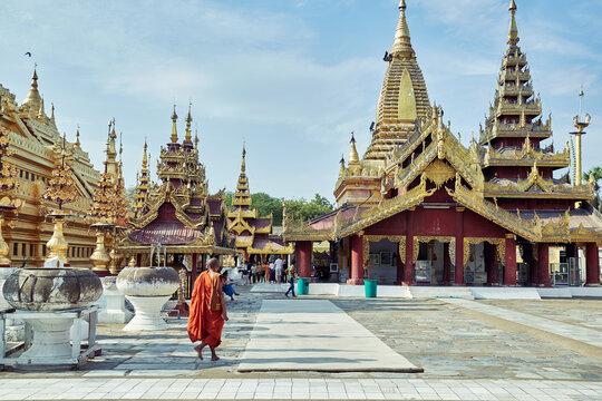 Buddhist monk walking near Shwezigon Pagoda