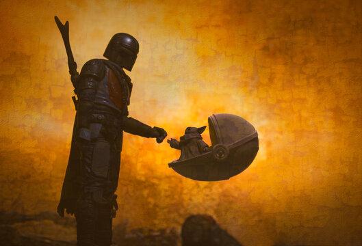 NEW YORK, USA - JUNE 20 2020: Star Wars scene from Disney Plus The Mandalorian with The Child aka Baby Yoda - Hasbro action figures
