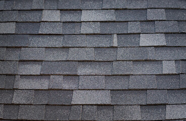 A pattern created by asphalt shingles on a roof.