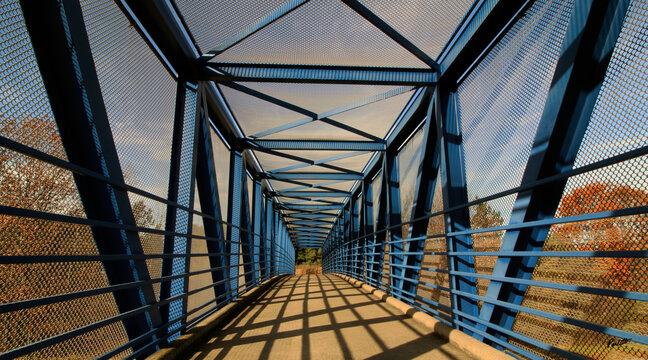 steel bridge over blue sky