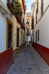 Narrow alley in the Old Town of Seville, Andalucia, Spain.
