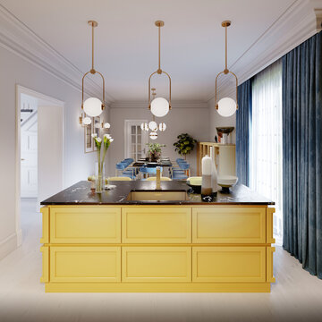 Modern kitchen island in yellow kitchen with pendant lamp over, yellow furniture black countertop.